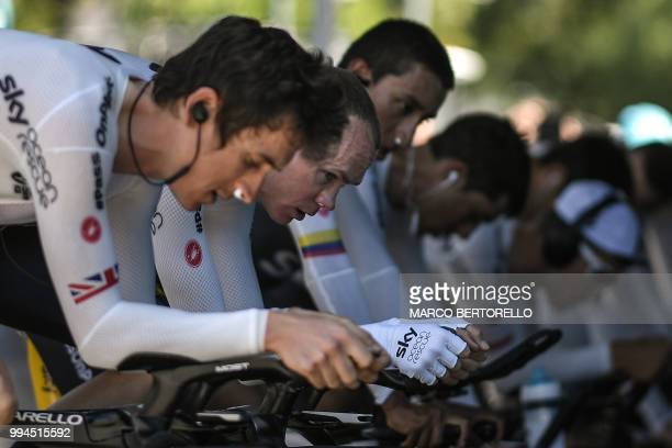 Great Britain's Christopher Froome and Great Britain's Geraint Thomas train on stationary bicycles prior to the third stage of the 105th edition of...