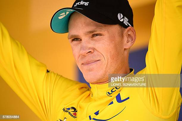 Great Britain's Christopher Froome celebrates his overall leader yellow jersey on the podium at the end of the 1845 km seventeenth stage of the 103rd...