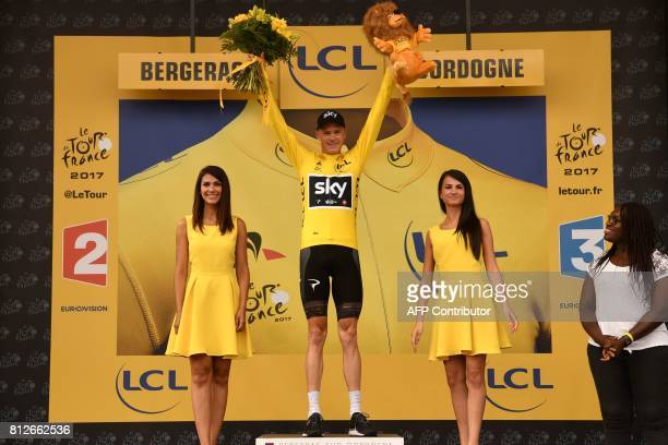 Great Britain's Christopher Froome celebrates his overall leader yellow jersey on the podium at the end of the 178 km tenth stage of the 104th...