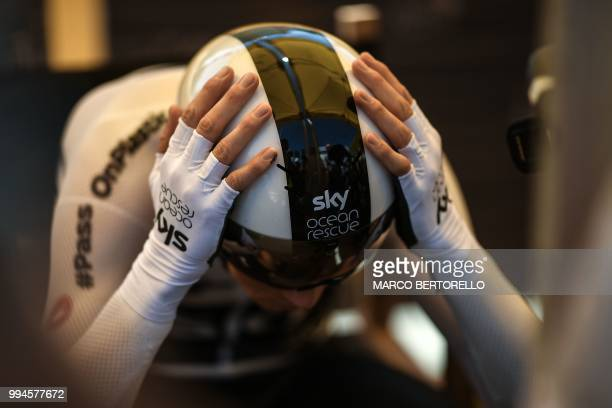 Great Britain's Christopher Froome concentrates prior to taking the start of the third stage of the 105th edition of the Tour de France cycling race...
