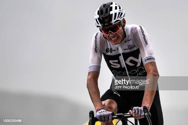 Great Britain's Christopher Froome crosses the finish line to place 8th of the 17th stage of the 105th edition of the Tour de France cycling race...