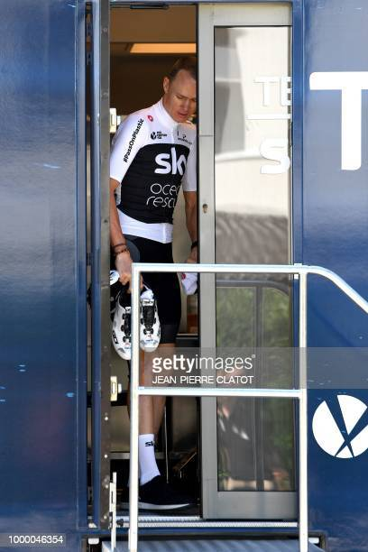 Great Britain's Christopher Froome leaves a team bus outside his team's hotel in Chambery to go for a training session with his Great Britain's Team...