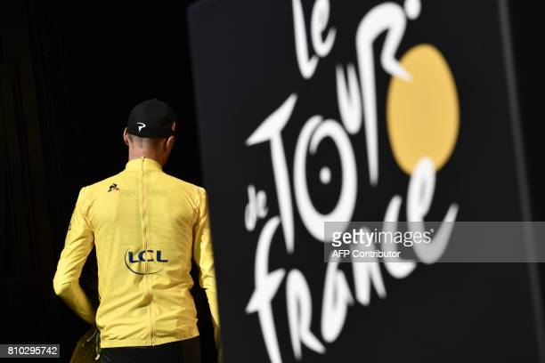 Great Britain's Christopher Froome leaves the podium after celebrating his overall leader yellow jersey at the end of the 2135 km seventh stage of...