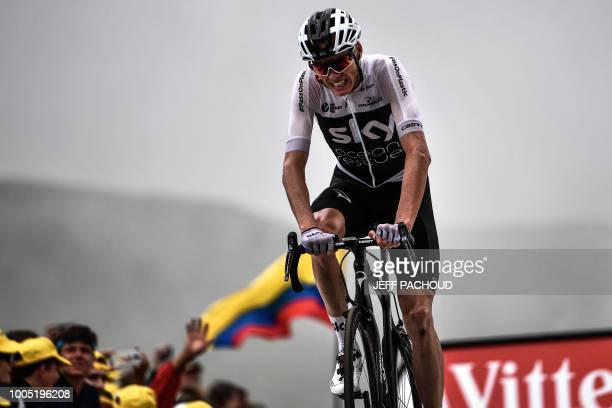 TOPSHOT Great Britain's Christopher Froome looks crosses the finish line to place 8th of the 17th stage of the 105th edition of the Tour de France...