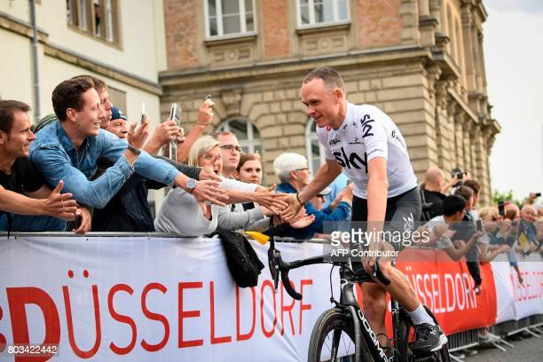 Great Britain's Christopher Froome parades during the team presentation ceremony in Dusseldorf Germany on June 29 two days before the start of the...