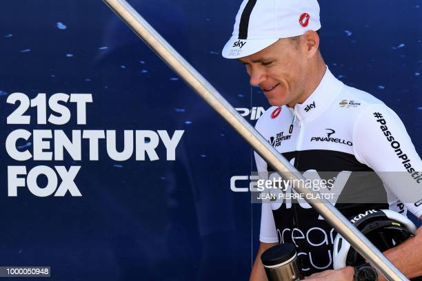 Great Britain's Christopher Froome prepares outside his team's hotel in Chambery to go for a training session with his Great Britain's Team Sky...