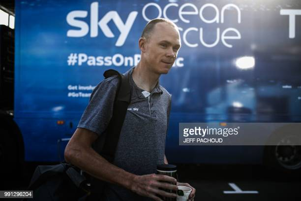 Great Britain's Christopher Froome prepares to board his Team Sky cycling team bus as he departs from his hotel for a training session on July 4 2018...