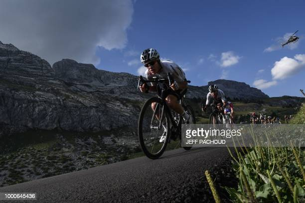 Great Britain's Christopher Froome rides down after the Colombiere pass during the tenth stage of the 105th edition of the Tour de France cycling...