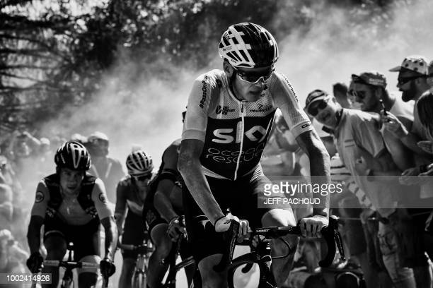 Great Britain's Christopher Froome rides through the socalled 'Dutch Corner' in the ascent to l'Alpe d'Huez during the twelfth stage of the 105th...