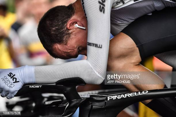 Great Britain's Christopher Froome trains on a stationary bicycle prior to take the start of the 20th stage of the 105th edition of the Tour de...