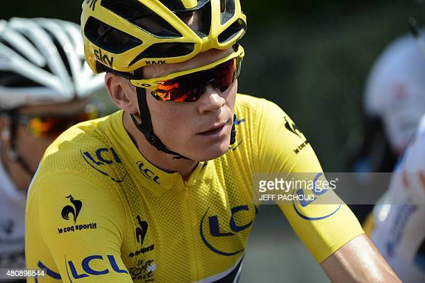Great Britain's Christopher Froome wearing the overall leader's yellow jersey takes the start of the 195 km twelfth stage of the 102nd edition of the...