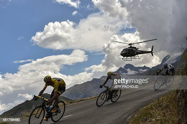 Great Britain's Christopher Froome wearing the overall leader's yellow jersey rides ahead of Spain's Alejandro Valverde and Colombia's Nairo Quintana...