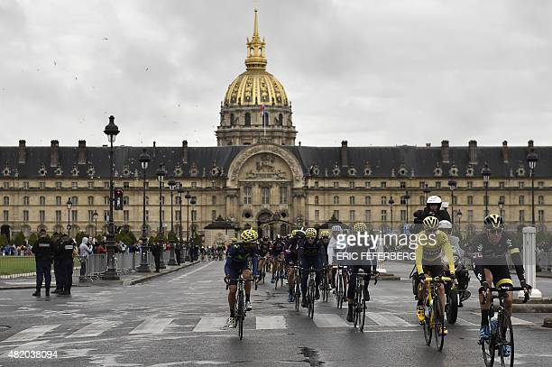 Great Britain's Christopher Froome wearing the overall leader's yellow jersey rides in front of the Hotel des Invalides in Paris during the 1095 km...