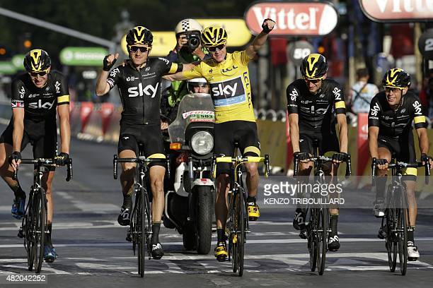 Great Britain's Christopher Froome wearing the overall leader's yellow jersey arrives with his teammates of the Great Britain's Sky cycling team...