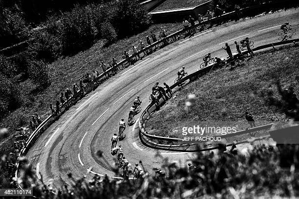 Great Britain's Christopher Froome wearing the overall leader's yellow jersey rides during the 1105 km twentieth stage of the 102nd edition of the...