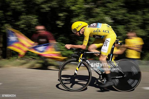 TOPSHOT Great Britain's Christopher Froome wearing the overall leader's yellow jersey competes during the 375 km individual timetrial the thirteenth...