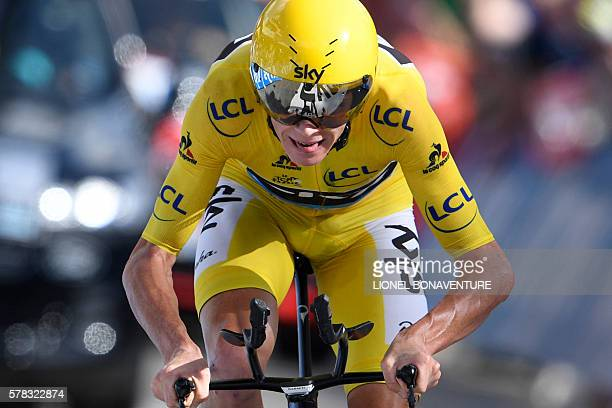 TOPSHOT Great Britain's Christopher Froome wearing the overall leader's yellow jersey crosses the finish line at the end of the 17 km individual...