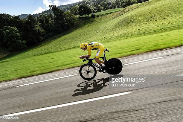 TOPSHOT Great Britain's Christopher Froome wearing the overall leader's yellow jersey rides during the 17 km individual timetrial the eighteenth...