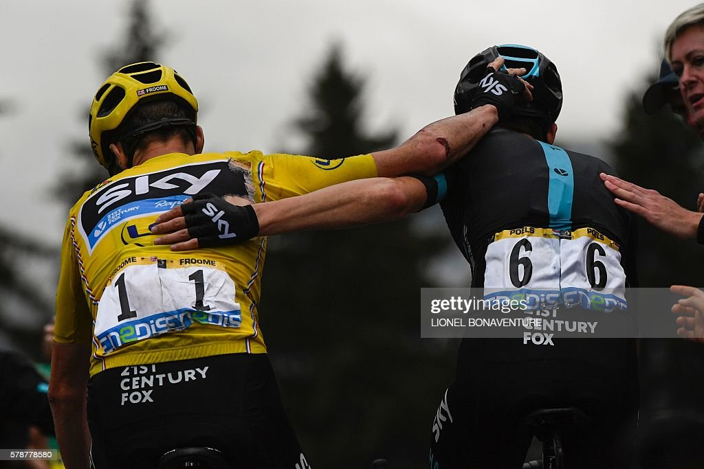 Great Britain's Christopher Froome (L), wearing the overall leader's yellow jersey, and Netherlands' Wouter Poels congratulate each other after crossing the finish line at the end of the 146 km nineteenth stage of the 103rd edition of the Tour de France cycling race on July 22, 2016 between Albertville and Saint-Gervais Mont Blanc, French Alps. BONAVENTURE