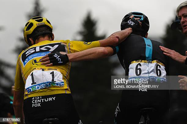Great Britain's Christopher Froome wearing the overall leader's yellow jersey and Netherlands' Wouter Poels congratulate each other after crossing...