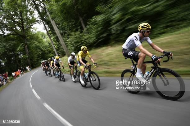 TOPSHOT Great Britain's Christopher Froome wearing the overall leader's yellow jersey rides behind his teammate Great Britain's Luke Rowe during the...