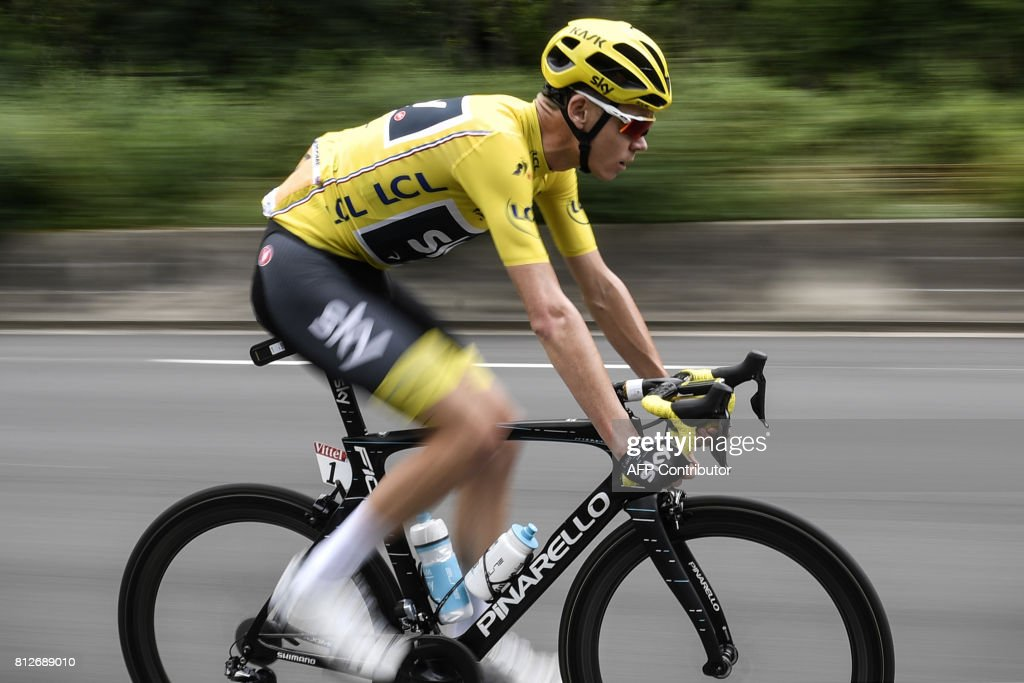Great Britain's Christopher Froome, wearing the overall leader's yellow jersey, rides during the 178 km tenth stage of the 104th edition of the Tour de France cycling race on July 11, 2017 between Perigueux and Bergerac. / AFP PHOTO / Jeff PACHOUD