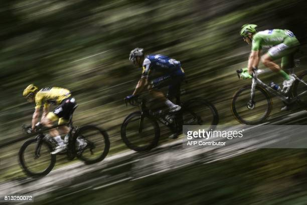 Great Britain's Christopher Froome wearing the overall leader's yellow jersey New Zealand's Jack Bauer and Germany's Marcel Kittel wearing the best...