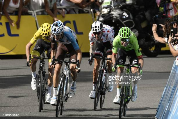 Great Britain's Christopher Froome wearing the overall leader's yellow jersey France's Romain Bardet France's Warren Barguil wearing the best...