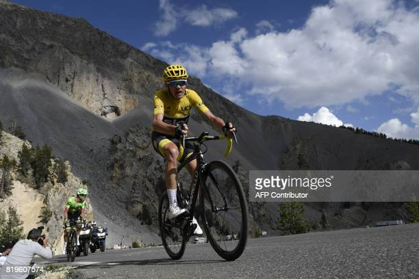 Great Britain's Christopher Froome wearing the overall leader's yellow jersey rides ahead of Colombia's Rigoberto Uran during the 1795 km eighteenth...