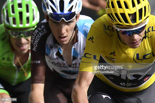 Great Britain's Christopher Froome wearing the overall leader's yellow jersey France's Romain Bardet and Colombia's Rigoberto Uran climb the Col...