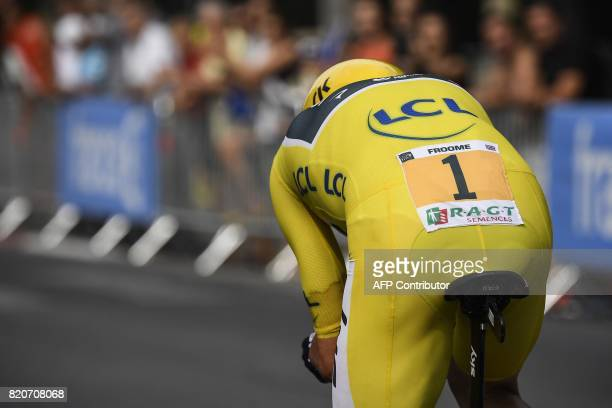 Great Britain's Christopher Froome wearing the overall leader's yellow jersey competes in a 225 km individual timetrial the twentieth stage of the...