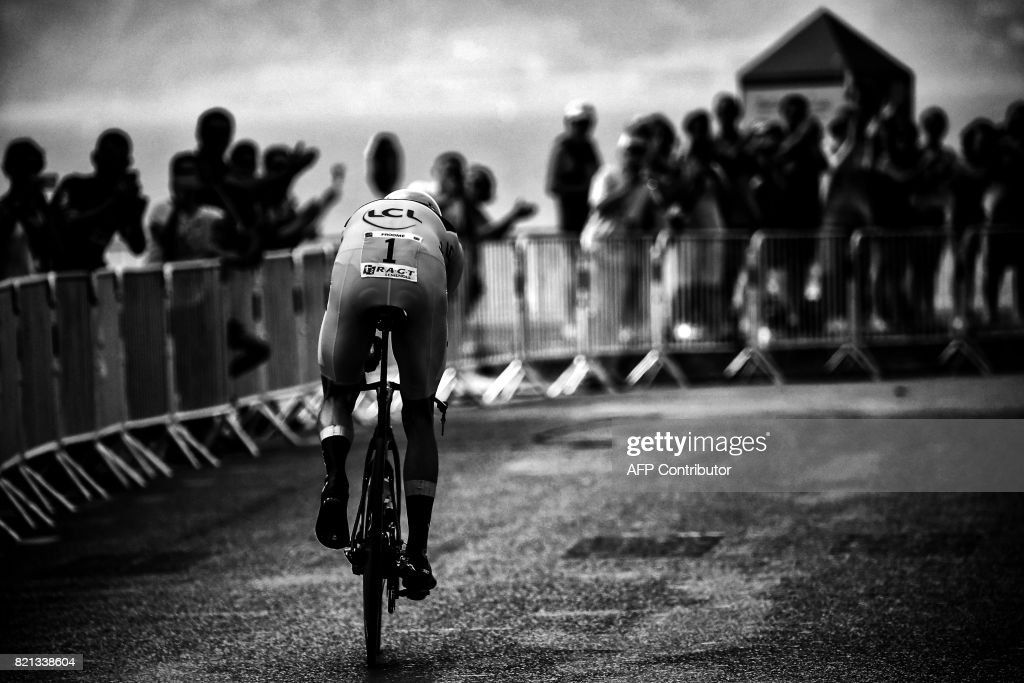 Great Britain's Christopher Froome wearing the overall leader's yellow jersey competes in a 22,5 km individual time-trial, the twentieth stage of the 104th edition of the Tour de France cycling race on July 22, 2017 in and around Marseille, southern France. /