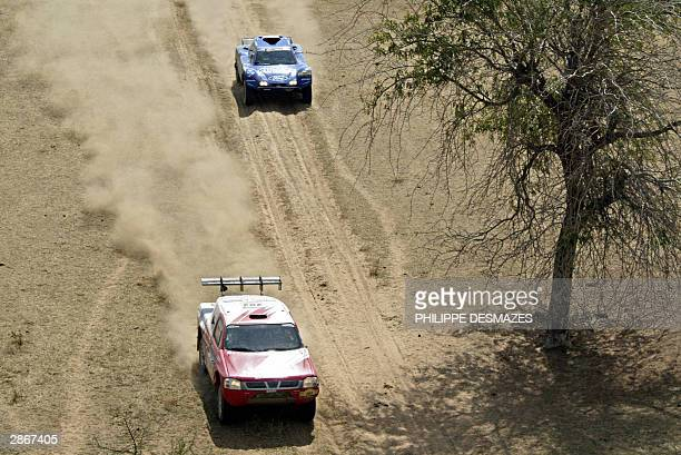 Great Britain's Coli Mc Rae on Nissan passes over France's JeanLouis Schlesser on Schlesser Ford during the 13th stage of the 26th edition of the...