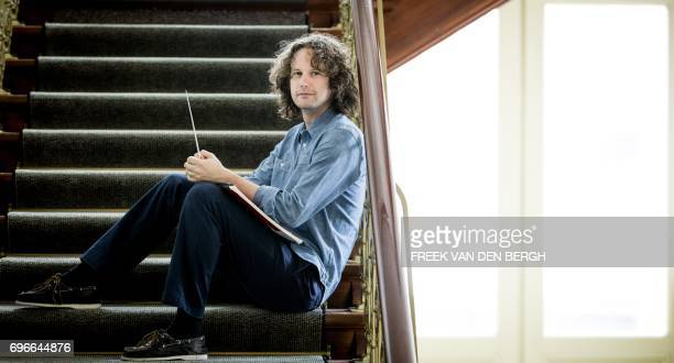 Great Britain's conductor Nicholas Collon poses in The Hague on June 16 2017 Collon is the new chefconductor of the Dutch orchestra for the season...