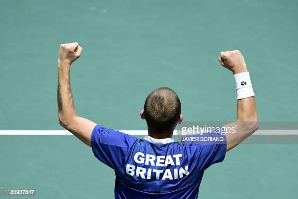 Great Britain's Daniel Evans celebrates after winning the singles quarter-final tennis match against Germany's Jan-Lennard Struff at the Davis Cup...