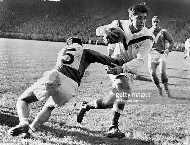 Great Britain's Dave Valentine breaks a tackle from France's Raymond Contrastin