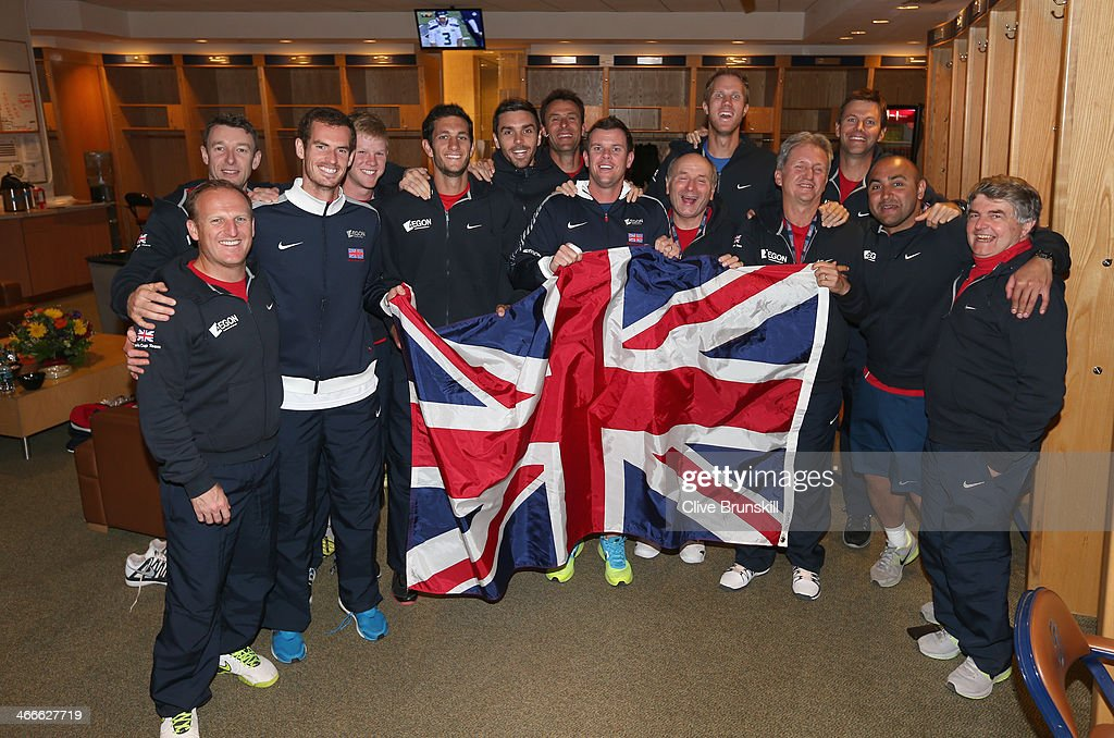 Great Britain's Davis Cup team celebrate with the Union Jack in the dressing room after their 3-1 victory against of the United States during day three of the Davis Cup World Group first round between the U.S. and Great Britain at PETCO Park on February 2, 2014 in San Diego, California.