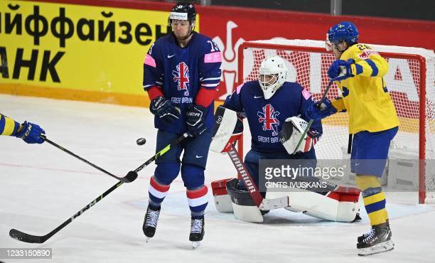 Great Britain's defender David Phillips reacts during the IIHF Men's Ice Hockey World Championships preliminary round group A match between Sweden...