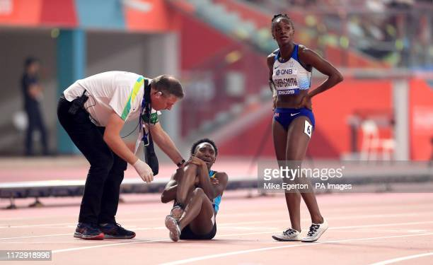 Great Britain's Dina AsherSmith shows concern for Bahamas Anthonique Strachan who picked up an injury in her Womens 200m semifinal during day five of...