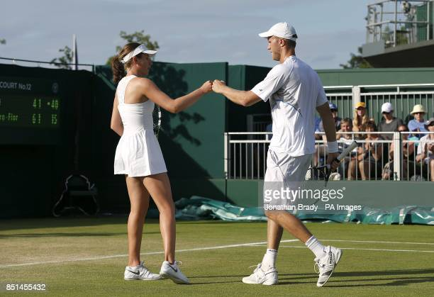 Great Britain's Dominic Inglot and Johanna Konta celebrate a point in their mixed doubles match against Spain's Nicolas Almagro and MariaTeresa...