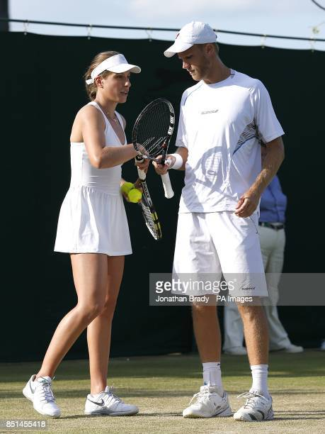 Great Britain's Dominic Inglot and Johanna Konta in their mixed doubles match against Spain's Nicolas Almagro and MariaTeresa TorroFlor during day...