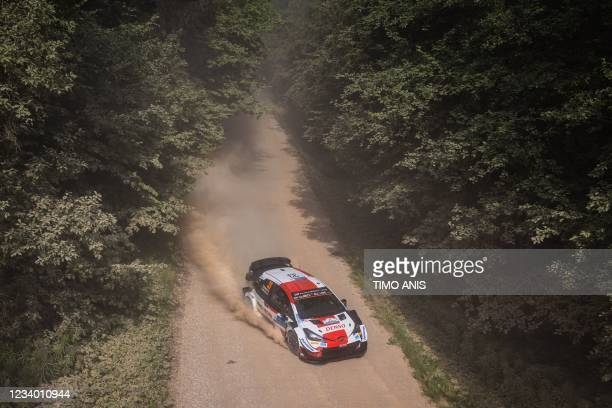Great Britain's driver Elfyn Evans and Great Britain's co-driver Scott Martin steer their Toyota Yaris WRC car during the Arula stage two of the WRC...