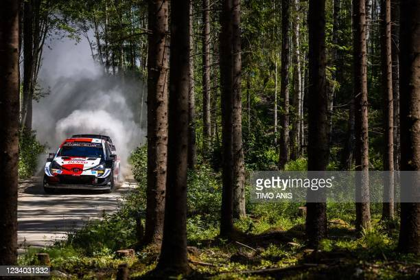Great Britain's driver Elfyn Evans and Great Britain's co-driver Scott Martin steer their Toyota Yaris WRC car during stage 13 of the WRC Rally...