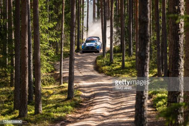 Great Britain's driver Gus Greensmith and Ireland's co-driver Chris Patterson steer their Ford Fiesta WRC car during stage 15 Mustvee of the WRC...