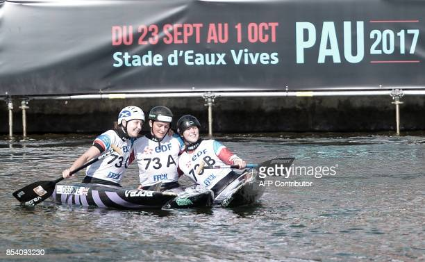 Great Britain's Eilidh Gibson Mallory Franklin and Kimberley Woods react after winning the women's team event in the Canoe Single category on...