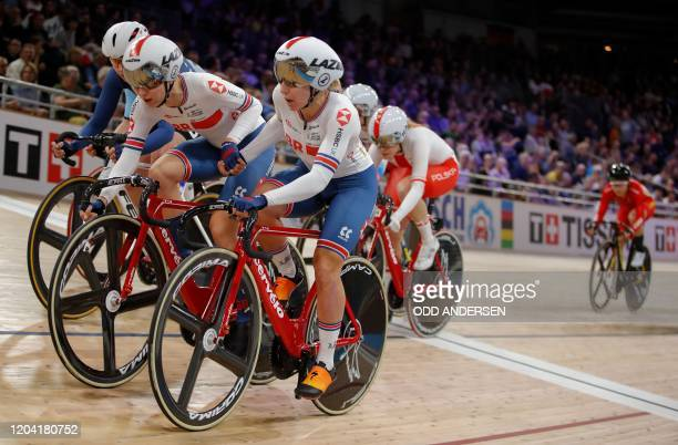 Great Britain's Elinor Barker and Great Britain's Neah Evans hand over during the women's 30km Madison final at the UCI track cycling World...