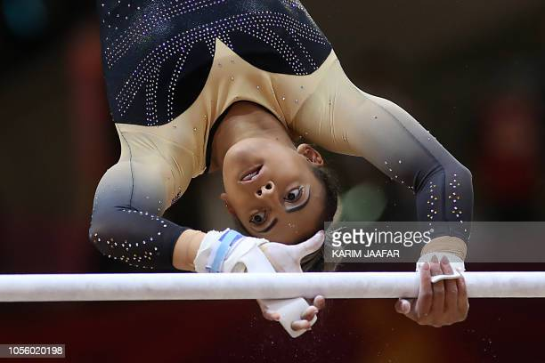 TOPSHOT Great Britain's Elissa Downie competes in the women's allaround final of the 2018 FIG Artistic Gymnastics Championships at the Aspire Dome on...