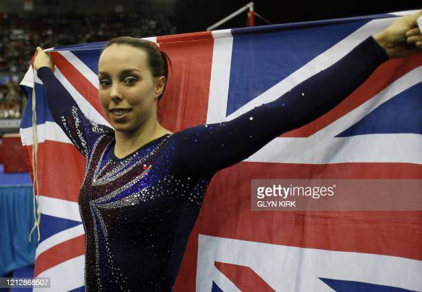 Great Britain's Elizabeth Tweddle poses with her national flag after after winning the floor and the uneven bars events of the women seniors...