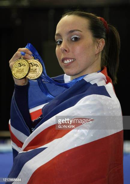 Great Britain's Elizabeth Tweddle poses with her two gold medals after winning the floor and the uneven bars events of the women seniors apparatus...