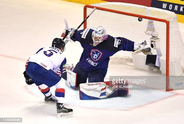 Great Britain's forward Benjamin Davies scores to win during overtime of the IIHF Men's Ice Hockey World Championships Group A match between France...